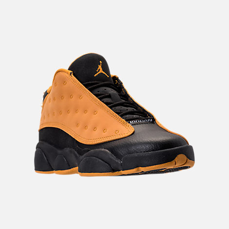 Three Quarter view of Boys' Grade School Air Jordan Retro 13 Low Basketball Shoes in Black/Chutney