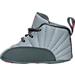 Left view of Air Jordan Retro 12 Crib Basketball Shoes in Wolf Grey/Vivid Pink/Cool Grey