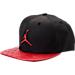 Front view of Kids' Air Jordan Retro 13 Snapback Hat in Black/Gym Red
