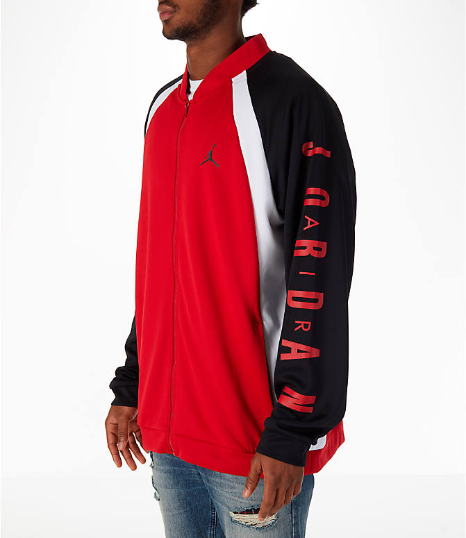 Front Three Quarter view of Men's Jordan Sportswear Jumpman Track Jacket in Gym Red/Black/White