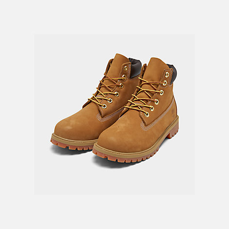 Three Quarter view of Big Kids' Timberland 6 Inch Classic Boots in Wheat
