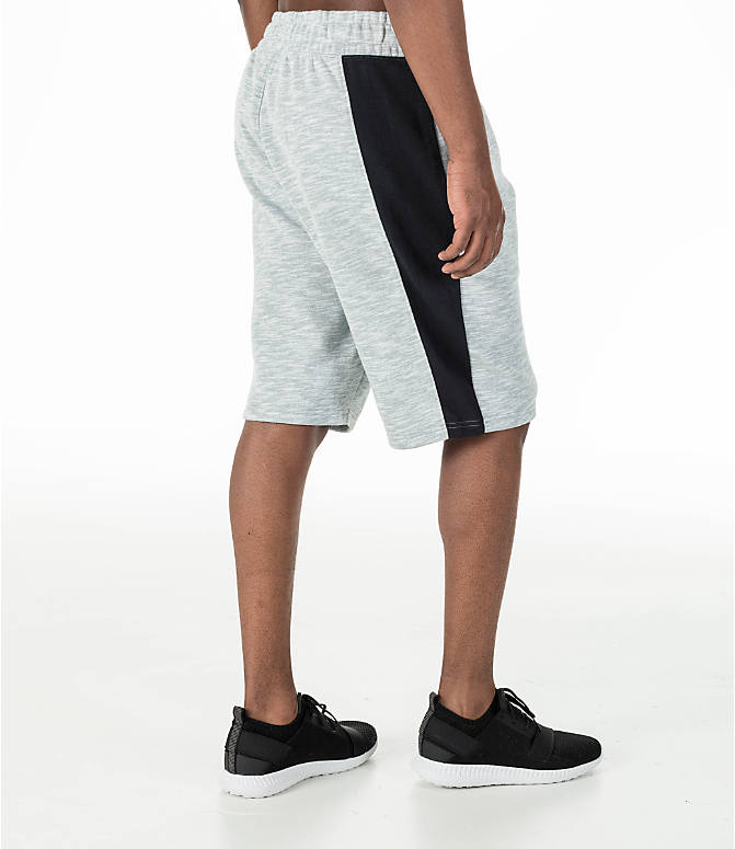 Back Right view of Men's Under Armour Baseline Fleece Shorts in True Grey Heather/Black