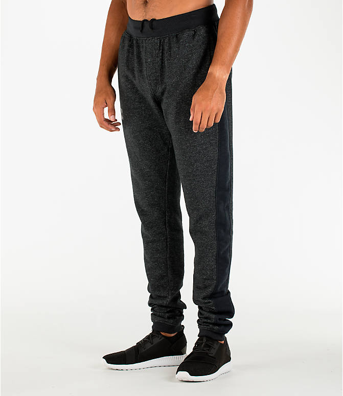 Front Three Quarter view of Men's Under Armour Sportstyle Stacked Terry Jogger Pants in Black/Black