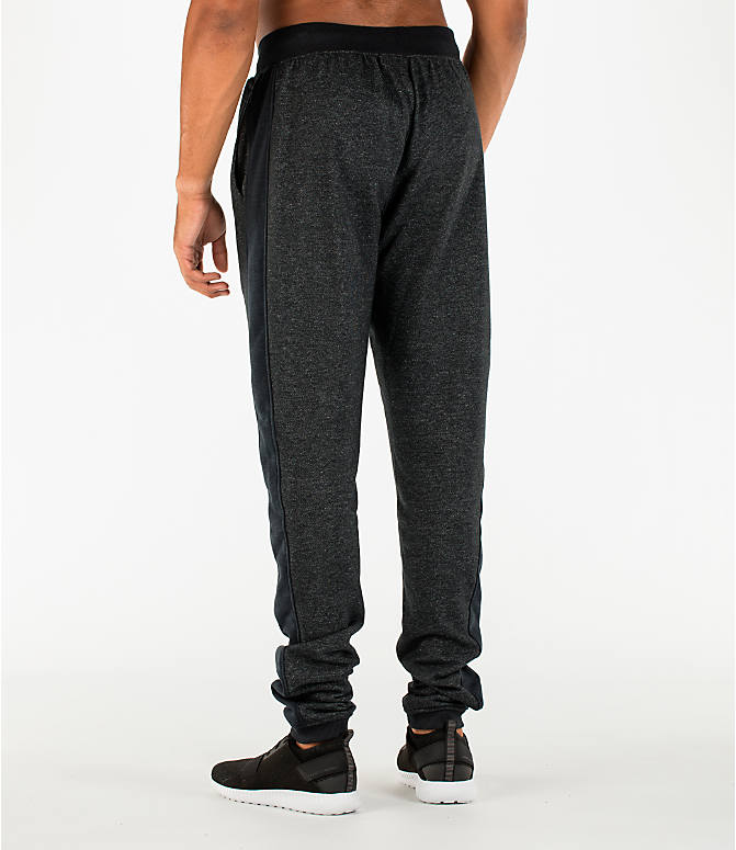 Back Left view of Men's Under Armour Sportstyle Stacked Terry Jogger Pants in Black/Black