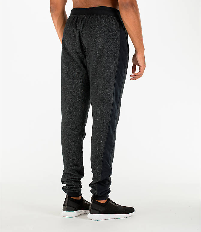 Back Right view of Men's Under Armour Sportstyle Stacked Terry Jogger Pants in Black/Black