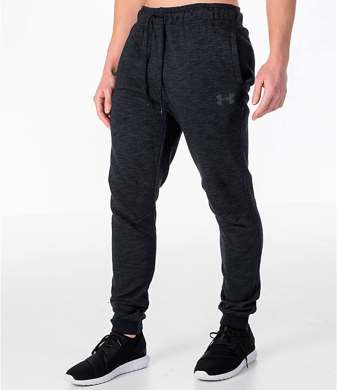 Front Three Quarter view of Men's Under Armour Baseline Tapered Jogger Pants in Black/Black