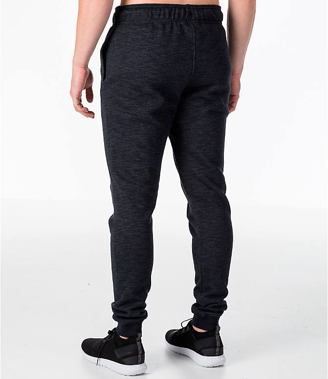 Back Left view of Men's Under Armour Baseline Tapered Jogger Pants in Black/Black