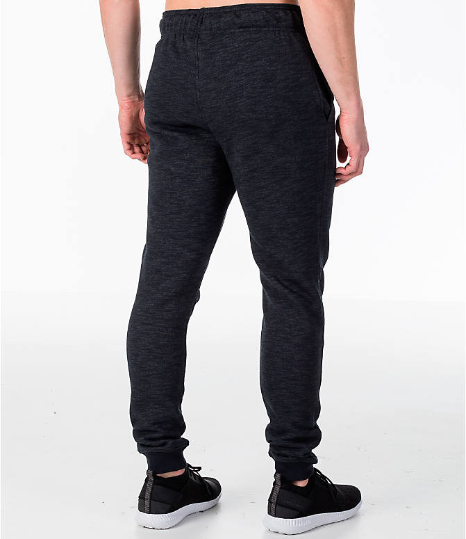 Back Right view of Men's Under Armour Baseline Tapered Jogger Pants in Black/Black
