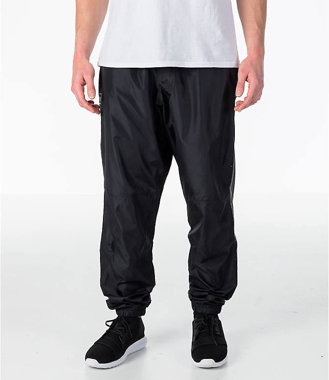 Front view of Men's Under Armour Sportstyle Wind Pants in Black