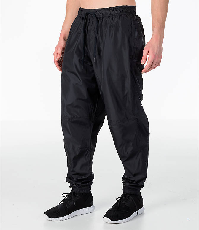 Front Three Quarter view of Men's Under Armour Sportstyle Wind Pants in Black