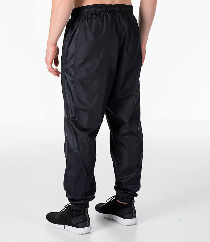 Back Left view of Men's Under Armour Sportstyle Wind Pants in Black