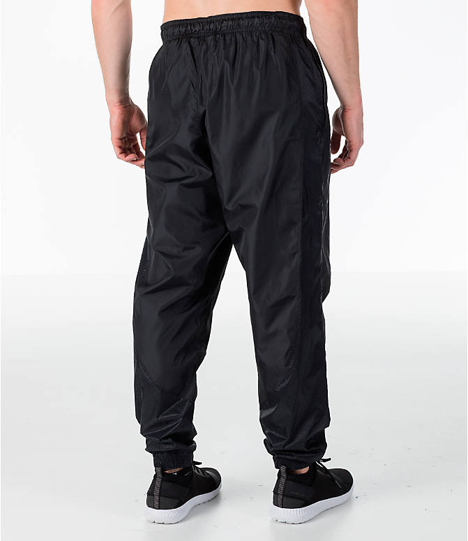Back Right view of Men's Under Armour Sportstyle Wind Pants in Black