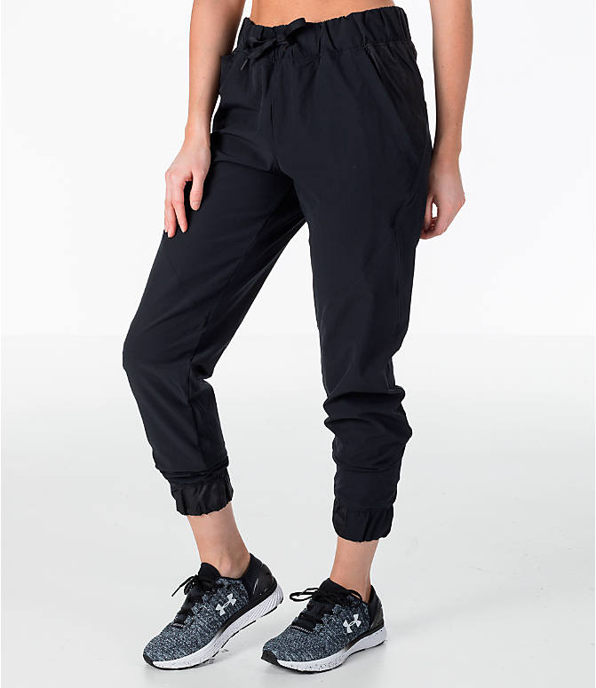 Front Three Quarter view of Women's Under Armour Storm Woven Jogger Pants in Black