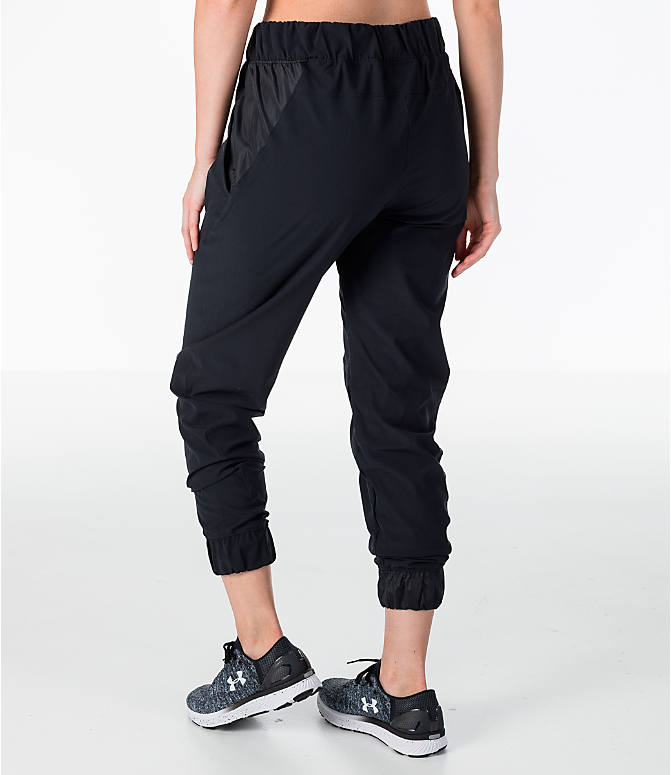 Back Left view of Women's Under Armour Storm Woven Jogger Pants in Black
