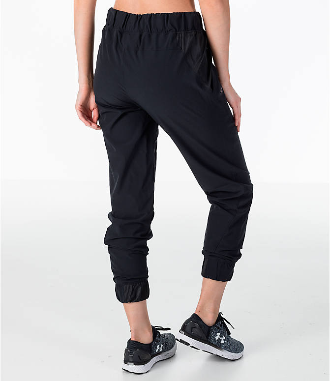 Back Right view of Women's Under Armour Storm Woven Jogger Pants in Black