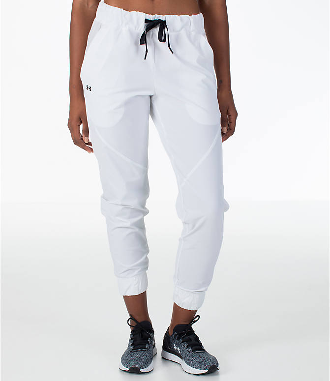 Front Three Quarter view of Women's Under Armour Storm Woven Jogger Pants in White/Black