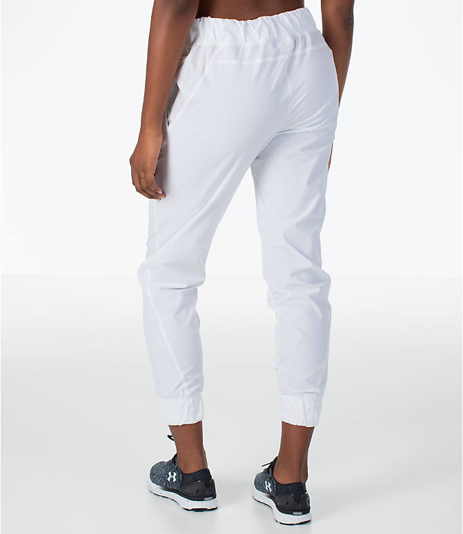 Back Left view of Women's Under Armour Storm Woven Jogger Pants in White/Black