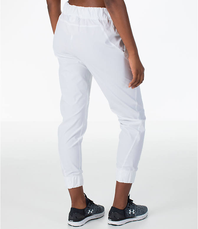 Back Right view of Women's Under Armour Storm Woven Jogger Pants in White/Black