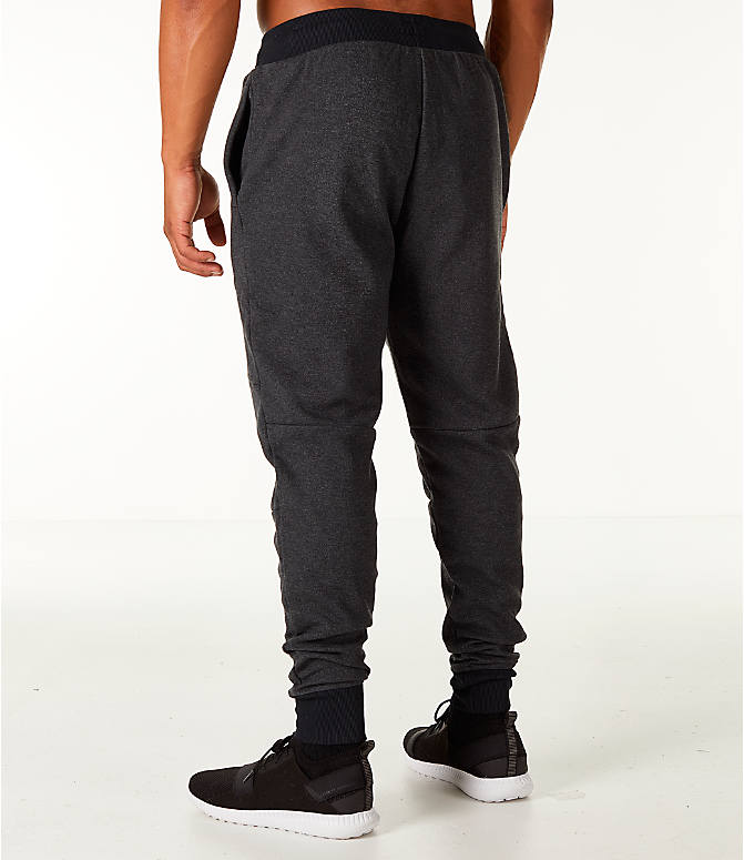 Back Left view of Men's Under Armour Unstoppable 2x Knit Jogger Pants in Black/Black