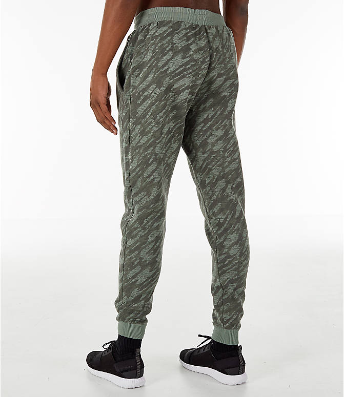 Back Right view of Men's Under Armour Rival Fleece Camo Jogger Pants in Moss Green