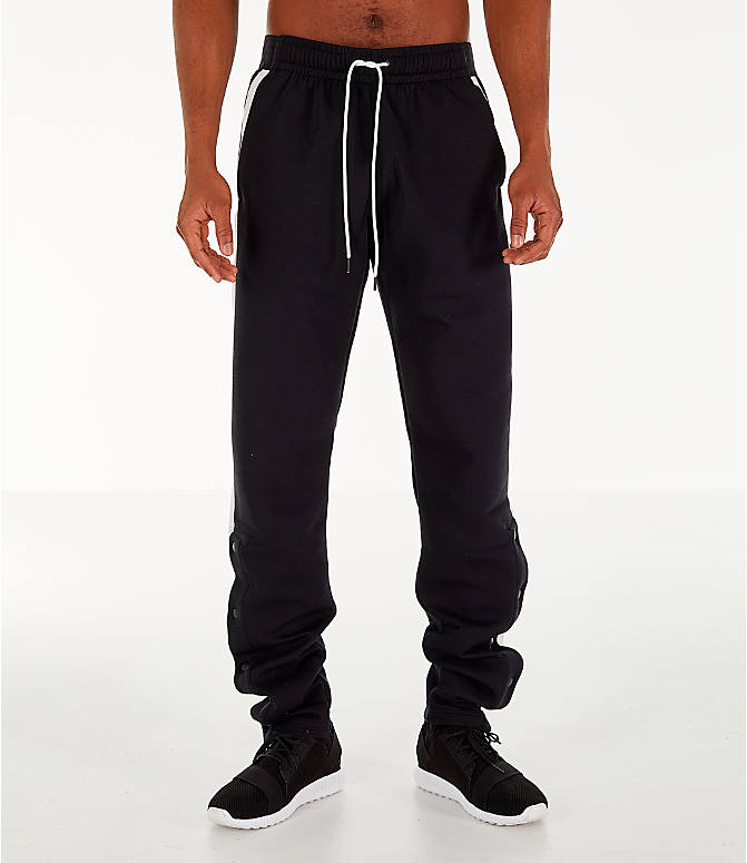 Front Three Quarter view of Men's Under Armour Pursuit Move Tearaway Training Pants in Black