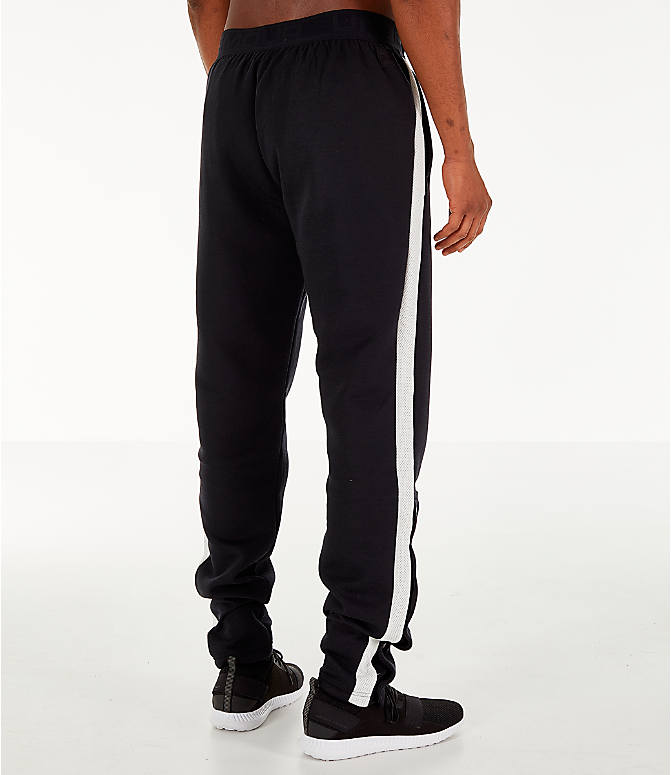 Back Right view of Men's Under Armour Pursuit Move Tearaway Training Pants in Black