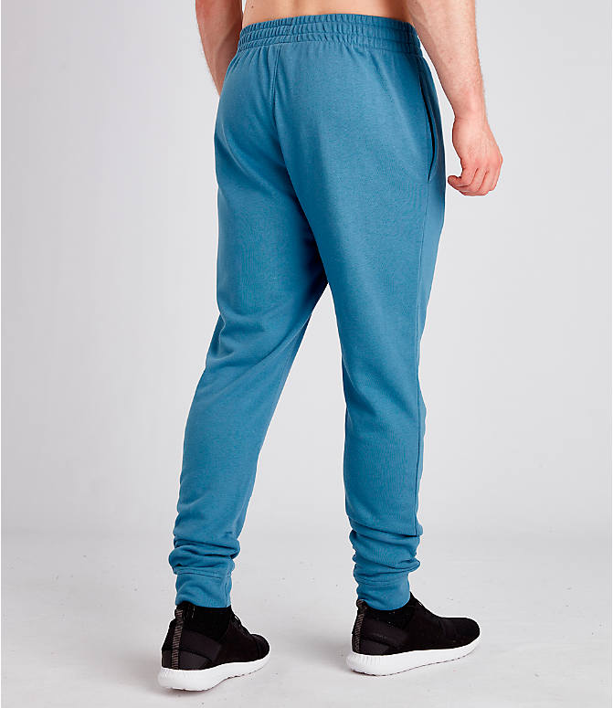 Back Right view of Men's Under Armour Sportstyle Terry Jogger Pants in Thunder
