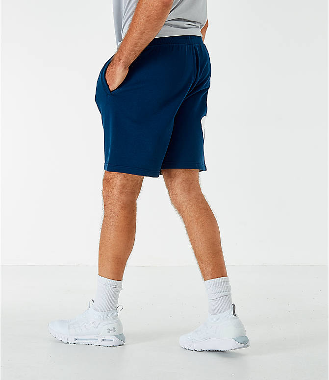 Back Right view of Men's Under Armour Rival Fleece Logo Shorts in Acedemy/White