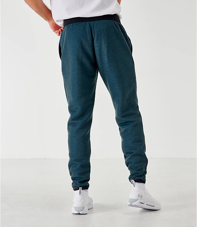 Back Left view of Men's Under Armour Unstoppable Move Light Jogger Pants in Dark Grey