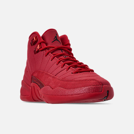 Three Quarter view of Big Kids' Air Jordan Retro 12 Basketball Shoes in Gym Red/Black