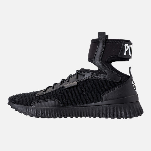 Left view of Women's Puma x Rihanna Fenty Trainer Mid Casual Shoes in Black