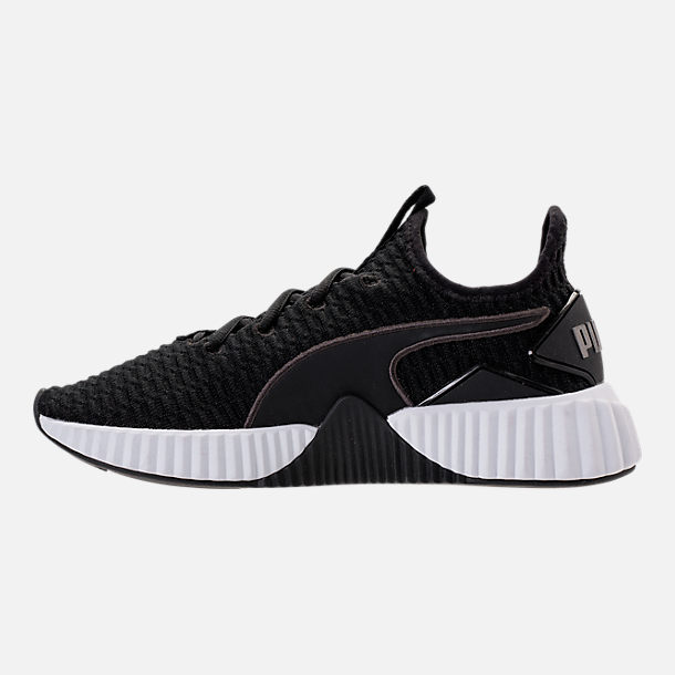Left view of Women's Puma Defy Casual Shoes in Black/White