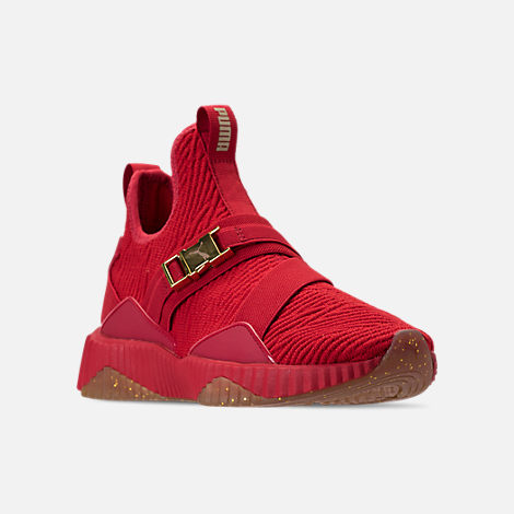 Three Quarter view of Women's Puma Defy Mid Casual Shoes in Red/Metallic Gold