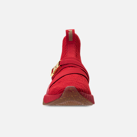 Front view of Women's Puma Defy Mid Casual Shoes in Red/Metallic Gold
