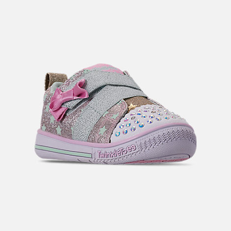 Three Quarter view of Girls' Toddler Skechers Twinkle Toes: Twinkle Play - Sparkle Shines Light Up Hook-and-Loop Casual Shoes in Glitter Star Print