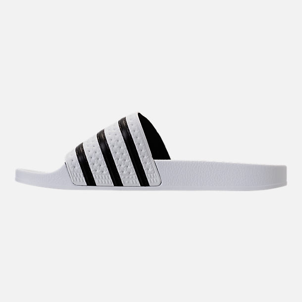 Left view of Men's adidas Adilette Slide Sandals in White/Core Black