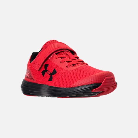 Three Quarter view of Boys' Little Kids' Under Armour Surge AC Hook-and-Loop Closure Running Shoes in Red/Black/Black