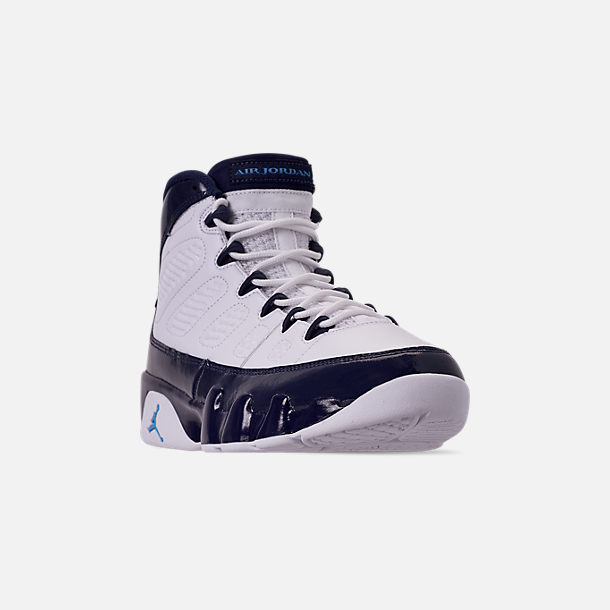 Three Quarter view of Men's Air Jordan Retro 9 Basketball Shoes in White/University Blue/Midnight Navy