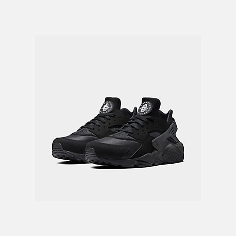 Three Quarter view of Men's Nike Air Huarache Run Running Shoes in Black/Black/White