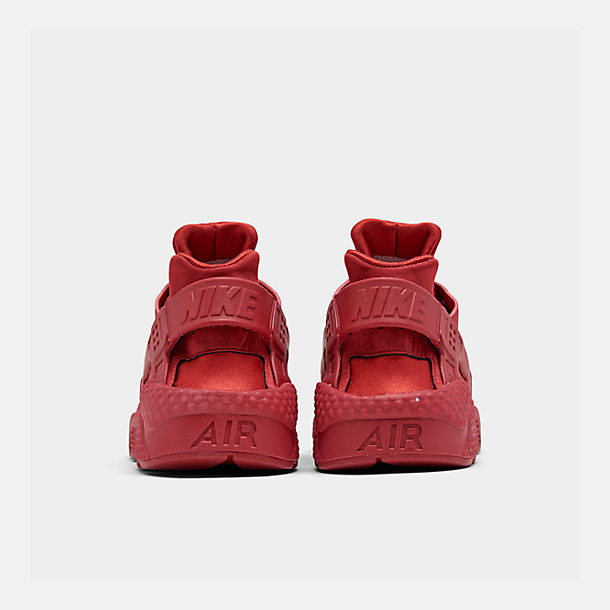 Left view of Men's Nike Air Huarache Run Running Shoes in Red/Red
