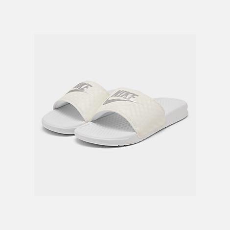 ae7944674 Three Quarter view of Women s Nike Benassi JDI Swoosh Slide Sandals in  White Metallic Silver
