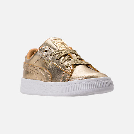 Three Quarter view of Girls' Toddler Puma Suede 50th Casual Shoes in Gold Leather