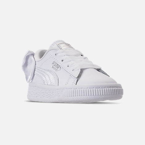 Three Quarter view of Girls' Toddler Puma Basket Bow Casual Shoes in White