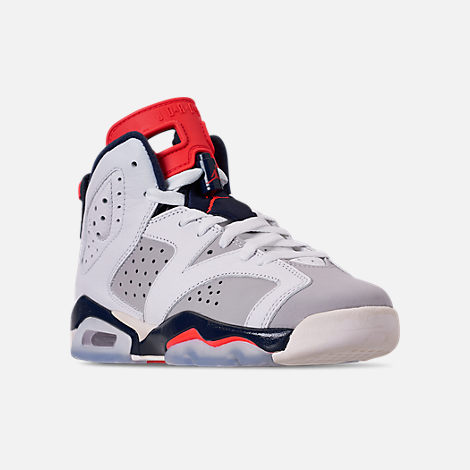 Three Quarter view of Big Kids' Air Jordan Retro 6 Basketball Shoes in White/Infrared 23/Neutral Grey/Obsidian