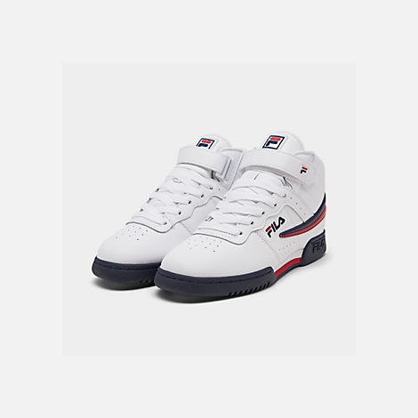 Three Quarter view of Boys' Big Kids' Fila F-13 Hook-and-Loop Training Shoes in White/Navy/Red