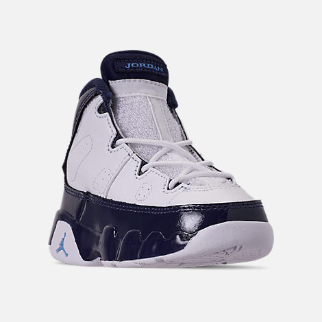 Three Quarter view of Kids' Toddler Air Jordan Retro 9 Basketball Shoes in White/University Blue/Midnight Navy