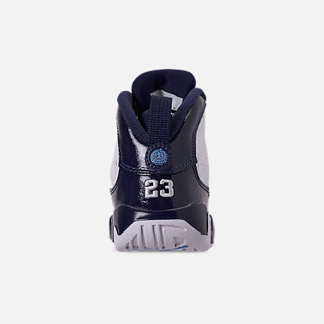 Back view of Kids' Toddler Air Jordan Retro 9 Basketball Shoes in White/University Blue/Midnight Navy