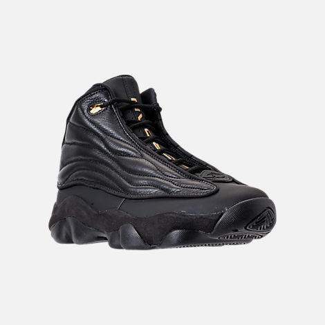 Three Quarter view of Men's Air Jordan Pro Strong Basketball Shoes in Black/Metallic Gold/Black