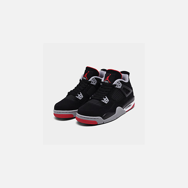 6c60831697c4 Three Quarter view of Big Kids  Air Jordan Retro 4 Basketball Shoes in  Black