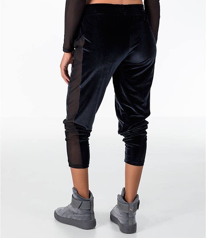 Back Left view of Women's Puma Yogini Velvet Pants in Black